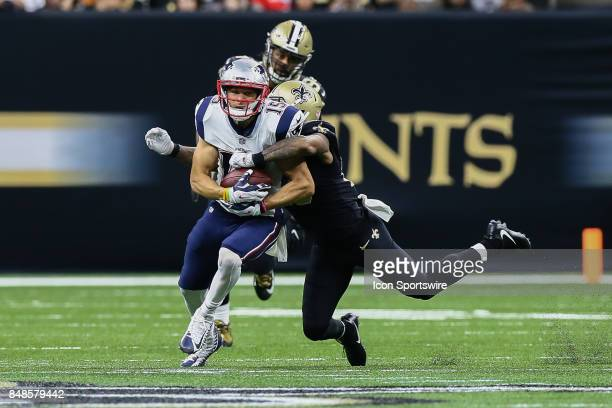 New England Patriots wide receiver Chris Hogan is tackled by New Orleans Saints cornerback PJ Williams during the game between between the New...