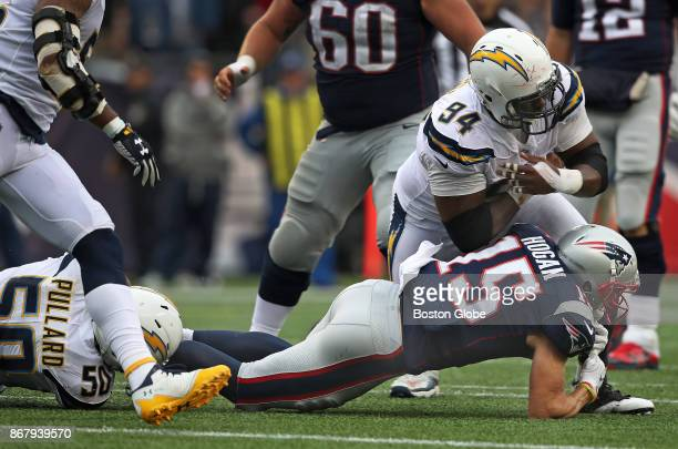 New England Patriots wide receiver Chris Hogan lands on his right arm as he is tackled by the Chargers Hayes Pullard and Corey Liuget in the fourth...