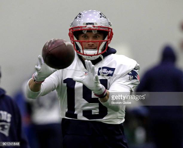 New England Patriots wide receiver Chris Hogan pulls in a pass during practice in Foxborough Mass on Jan 4 2018 A snow storm moved the day's practice...