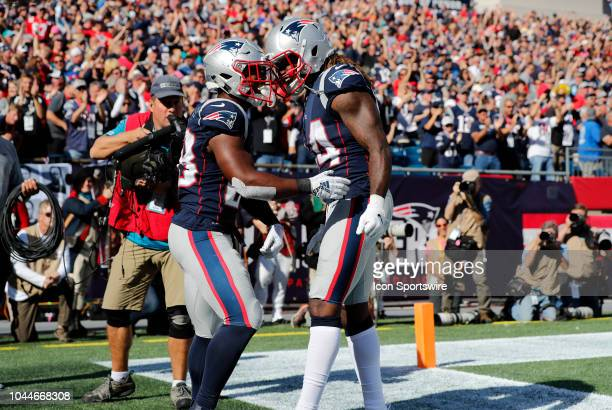 New England Patriots wide receiver Cordarrelle Patterson congratulates New England Patriots running back James White on his touchdown during a game...