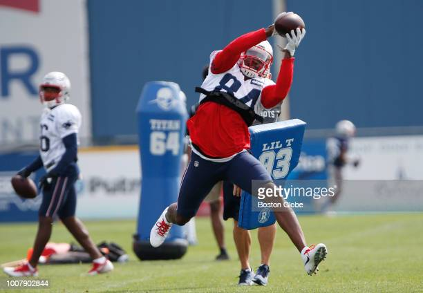 New England Patriots wide receiver Cordarrelle Patterson pulls down a pass during a drill at Patriots training camp at the Gillette Stadium practice...