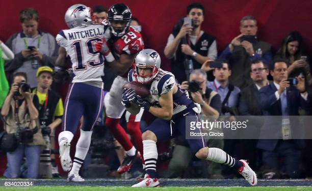 New England Patriots wide receiver Danny Amendola hauls in a fourth quarter touchdown pass from quarterback Tom Brady during the fourth quarter that...