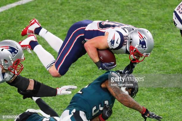 New England Patriots wide receiver Danny Amendola tries to hurdle over Philadelphia Eagles cornerback Rasul Douglas during Super Bowl LII on February...