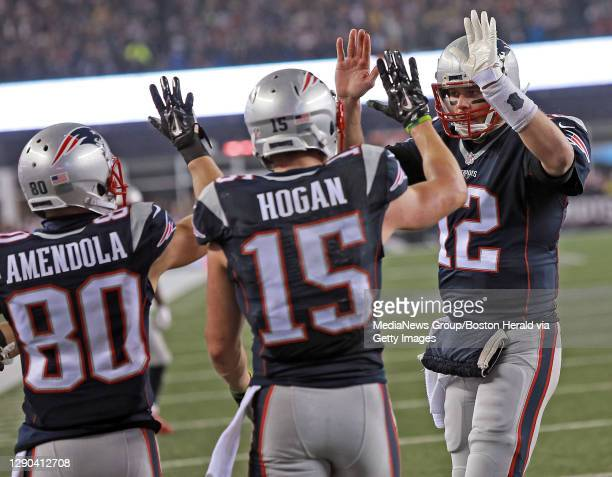 New England Patriots wide receiver Danny Amendola, wide receiver Chris Hogan and quarterback Tom Brady celebrate Hogan's touchdown during the first...