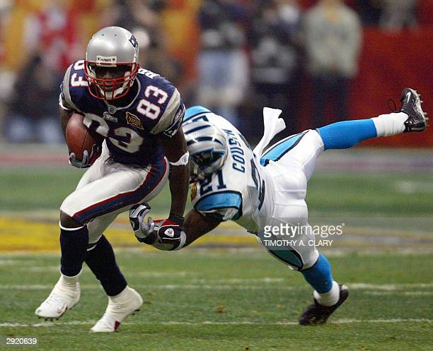 New England Patriots wide receiver Deion Branch breaks away from Terry Cousins of the Carolina Panthers in the first quarter of Super Bowl XXXVIII at...
