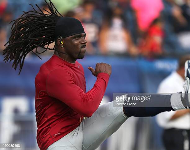 New England Patriots wide receiver Donte' Stallworth loosens up before the preseason exhibition game against the New Orleans Saints at Gillette...