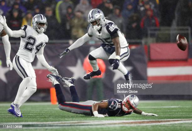 New England Patriots wide receiver Jakobi Meyers misses a catch as Dallas Cowboys safety Xavier Woods jumps over him during the third quarter. The...
