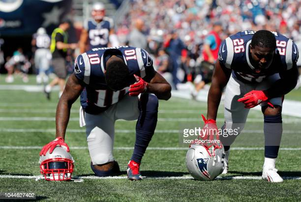 New England Patriots wide receiver Josh Gordon and New England Patriots running back Sony Michel pray before a game between the New England Patriots...