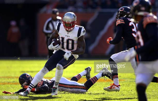 New England Patriots wide receiver Josh Gordon breaks several tackles after a reception during a fourth quarter touchdown drive The New England...