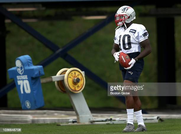 New England Patriots wide receiver Josh Gordon holds a ball during New England Patriots practice at the Gillette Stadium practice facility in...