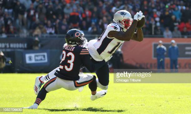 New England Patriots wide receiver Josh Gordon makes a catch over Chicago Bears cornerback Kyle Fuller in the second quarter on Sunday Oct 21 2018 at...