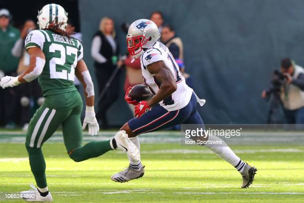 New England Patriots wide receiver Josh Gordon runs after the catch during the first quarter of the National Football League game between the New...