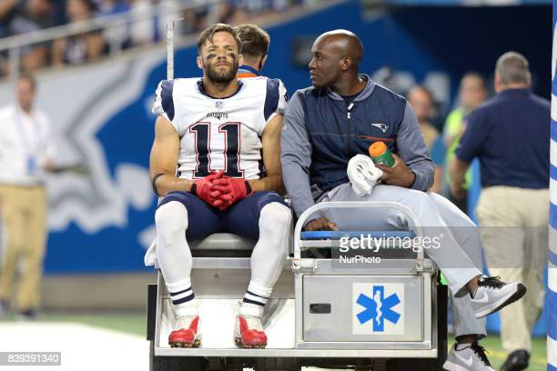 New England Patriots wide receiver Julian Edelman is taken off the field after an injury during the first half of an NFL football game against the...