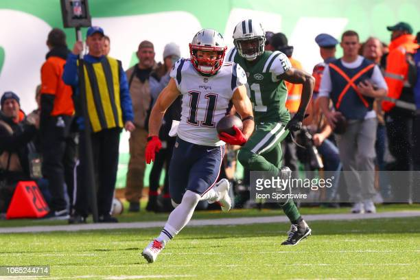 New England Patriots wide receiver Julian Edelman runs after the catch during the first quarter of the National Football League game between the New...