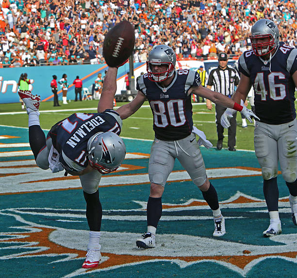 569ee290ccc New England Patriots wide receiver Julian Edelman ( 11) spikes the ball  after a