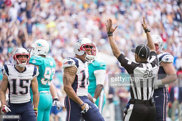 New England Patriots Wide Receiver Michael Floyd celebrates scoring a touchdown with New England Patriots Wide Receiver Julian Edelman as Field Judge...