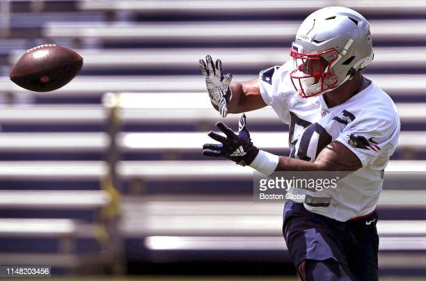 New England Patriots wide receiver N'Keal Harry reaches for a pass during day one of a Patriots threeday minicamp at Gillette Stadium in Foxborough...