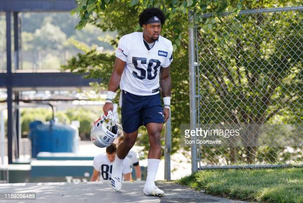 New England Patriots wide receiver NKeal Harry walks to the field during Patriots Training Camp on August 2 at their training facility outside...