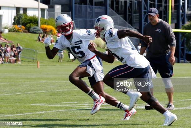 New England Patriots wide receiver Phillip Dorsett drives past New England Patriots wide receiver Dontrelle Inman as New England Patriots special...