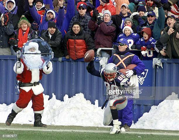 New England Patriots' wide receiver Terry Glenn celebrates with fans after scoring a touchdown seconds before the end of the first half against the...
