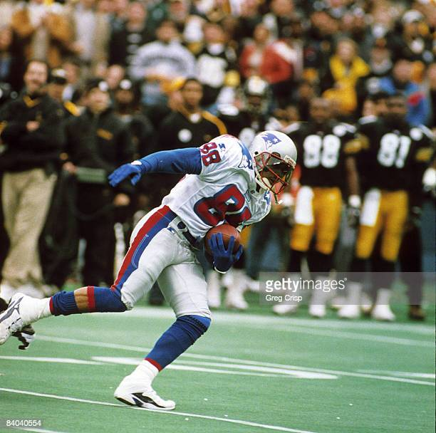 New England Patriots wide receiver Terry Glenn stumbles away from a defender during the AFC Divisional Playoff a 76 loss to the Pittsburgh Steelers...