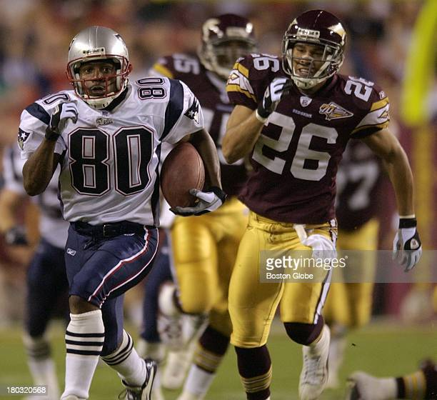 New England Patriots wide receiver Troy Brown runs down field on a punt return as Washington Redskins defensive back Ifeanyi Ohalete gives chase...