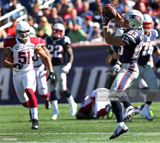 New England Patriots wide receiver Wes Welker pulls in a pass for a long catch and run for a first down in the second quarter as the New England...