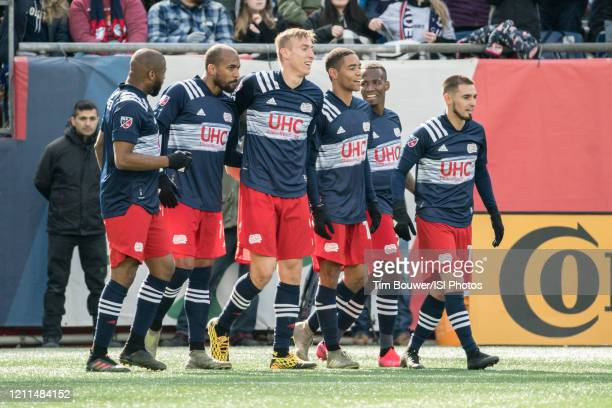 New England players celebrate their goal against Chicago during a game between Chicago Fire and New England Revolution at Gillette Stadium on March 7...