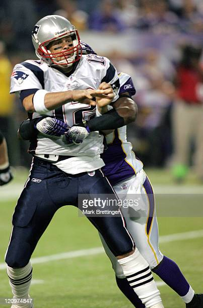 New England quarterback Tom Brady hit by Antoine Winfield during a game against the Minnesota Vikings on October 302006 in the Metrodome in...