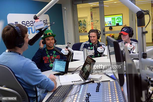 New England Revolution Charlie Davies and Kelyn Rowe do an interview in the Seacrest Studios with Jacob at Boston Children's Hospital March 10 2015...