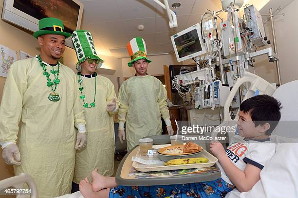 New England Revolution Charlie Davies Kelyn Rowe and Tyler Rudy visit Matthew at Boston Children's Hospital March 10 2015 in Boston Massachusetts