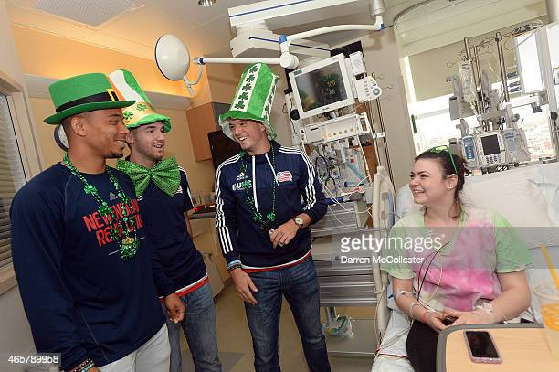 New England Revolution Charlie Davies Tyler Rudy and Kelyn Rowe visit Belle at Boston Children's Hospital March 10 2015 in Boston Massachusetts