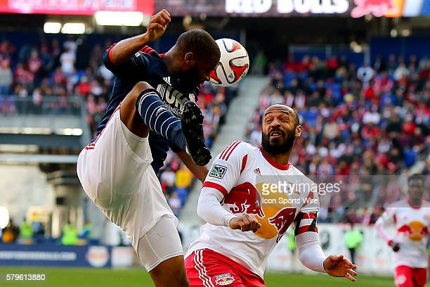 New England Revolution defender Andrew Farrell goes up for a head ball against New York Red Bulls forward Thierry Henry during the first half of the...