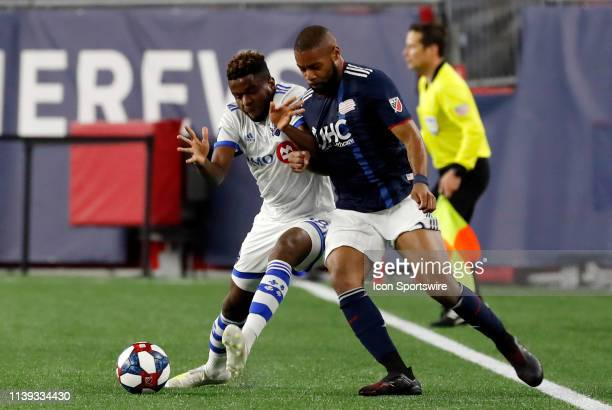 New England Revolution defender Andrew Farrell knocks Montreal Impact midfielder Orji Okwonkwo off the ball during a match between the New England...