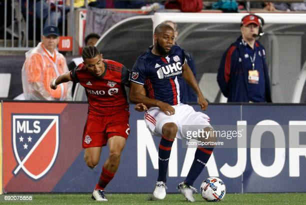 New England Revolution defender Andrew Farrell shields the ball from Toronto FC defender Justin Morrow during a regular season MLS match between the...