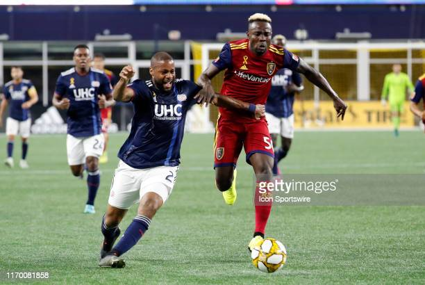 New England Revolution defender Andrew Farrell tries to fend off Real Salt Lake forward Sam Johnson during a match between the New England Revolution...