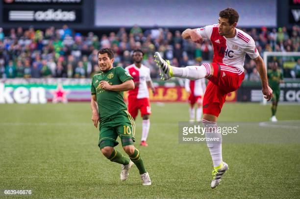 New England Revolution defender Antonio Minar Delamea clears a ball directed to Portland Timbers Sebastian Blanco during the first half of the New...