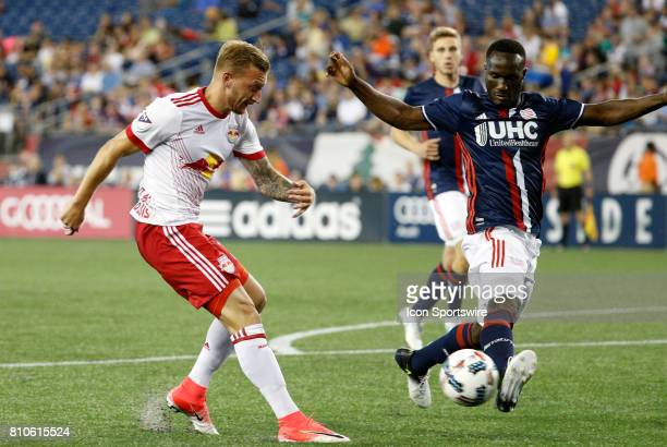 New England Revolution defender Benjamin Angoua blocks a shot from New York Red Bulls midfielder Daniel Royer during a regular season MLS match...