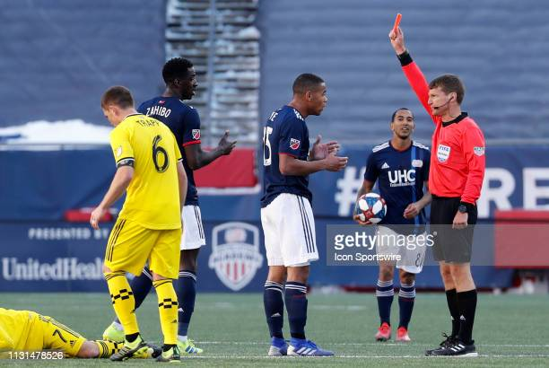 New England Revolution defender Brandon Bye is initially red carded by referee Dave Gantar during a match between the New England Revolution and...