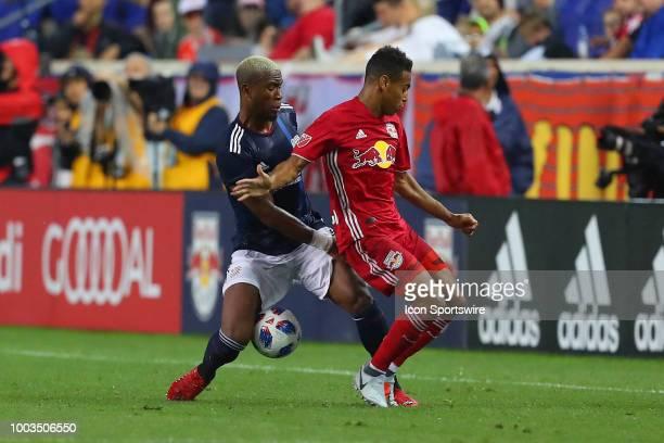 New England Revolution defender Claude Dielna battles New York Red Bulls midfielder Tyler Adams during the second half of the Major League Soccer...