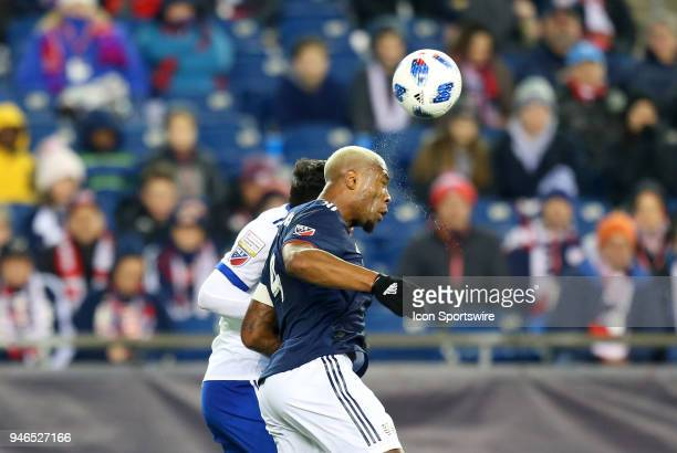 New England Revolution defender Claude Dielna heads the ball during a match between FC Dallas and New England Revolution on April 14 at Gillette...