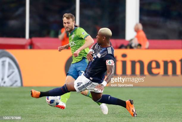 New England Revolution defender Claude Dielna stops the pass from Seattle Sounders FC midfielder Magnus Wolff Eikrem during a match between the New...