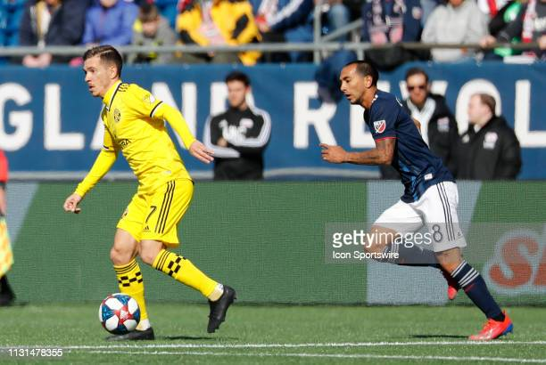 New England Revolution defender Edgar Castillo chases Columbus Crew midfielder Pedro Santos during a match between the New England Revolution and...