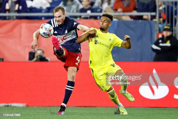 New England Revolution defender Henry Kessler plays the ball away from Nashville SC midfielder Hany Mukhtar during a match between the New England...