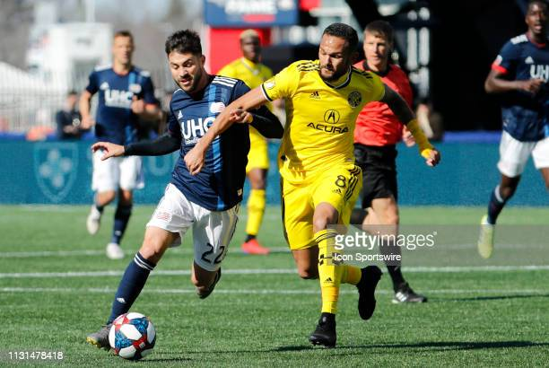 New England Revolution forward Carles Gil and Columbus Crew midfielder Artur battle for the ball during a match between the New England Revolution...