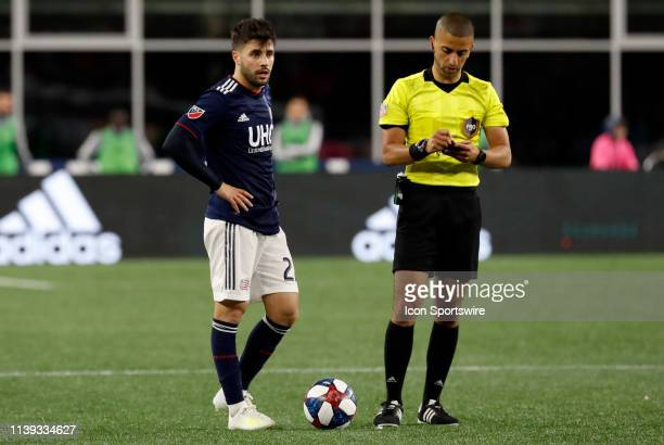 New England Revolution forward Carles Gil waits to put the ball back in play during a match between the New England Revolution and the Montreal...