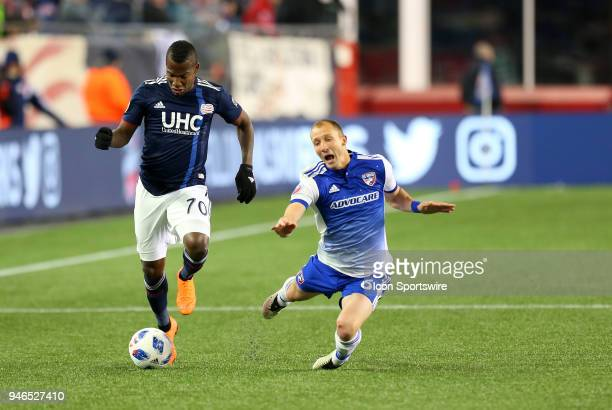 New England Revolution forward Cristian Penilla and FC Dallas defender Anton Nedyalkov in action during a match between FC Dallas and New England...
