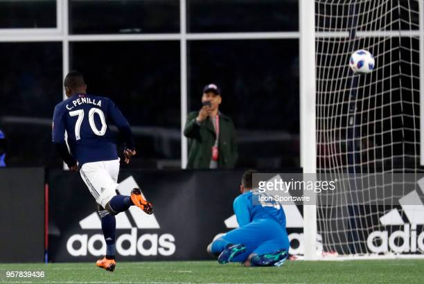 New England Revolution forward Cristian Penilla reacts as his shot beats Toronto FC goalkeeper Alex Bono for the first goal of the game during a...