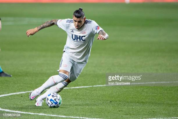 New England Revolution Forward Gustavo Bou dribbles the ball up the field during the first half of the Major League Soccer the Eastern Conference...