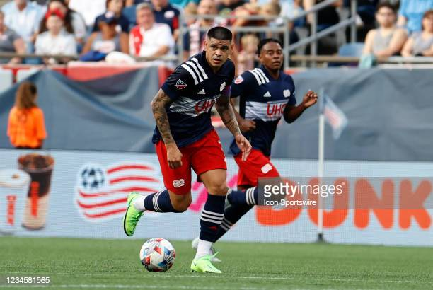 New England Revolution forward Gustavo Bou looks to pass during a match between the New England Revolution and the Philadelphia Union on August 8,...